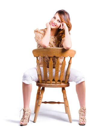 sexiness: Pin-up style woman posing on a chair