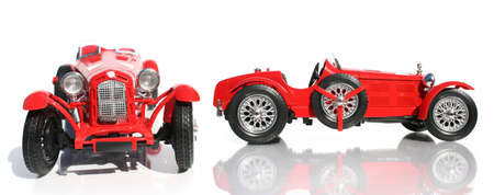 supercharged: Front And Side On Views Of An Classic Red Replica Model Car