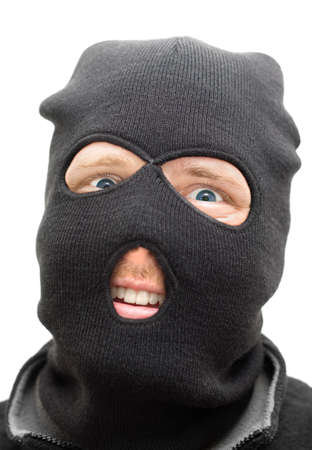 conman: Face Of A Cheeky Criminal With A Funny Smile Through A Black Ski Mask