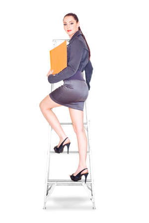 ladder: Metaphor Of A Ambitious Career Driven Female Business Woman Climbing The Steps Of Promotion While Stepping Up The Corporate Ladder Of Success And Achievement