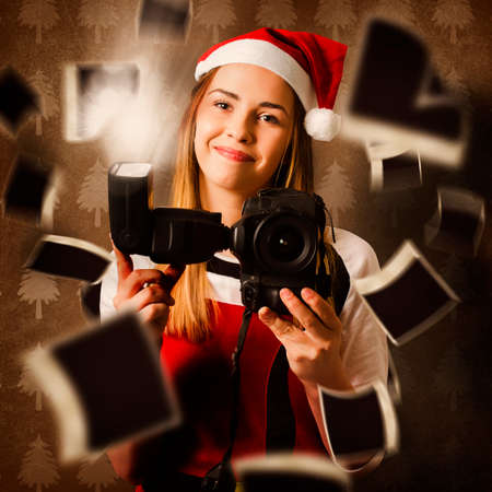 christmas memories: Creative photo on a camera holding santa helper taking christmas photos with Digital SLR underneath a abstract blur of happy snaps . Special moments and memories Stock Photo