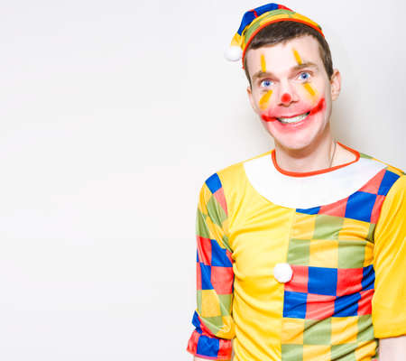 hilarity: Crazy Birthday Party Male Entertainer In Clown Costume Smiling On Copy Space Background