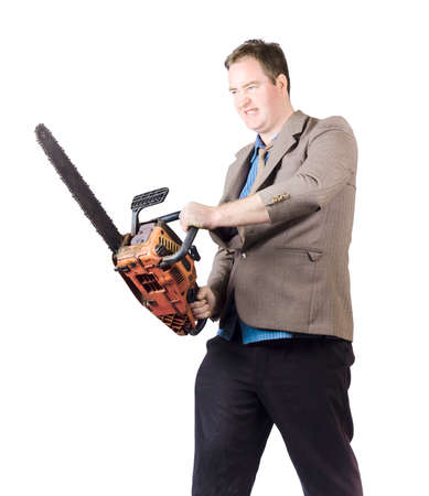 snarling: Isolated photograph of a managerial businessman holding chainsaw with snarling expression. Financial cutbacks