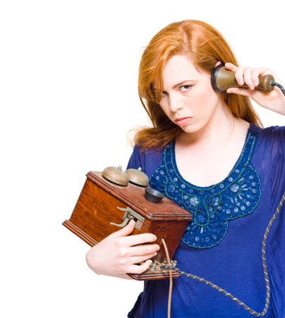 enraged: Angry And Enraged Woman Struggling To Establish A Connection To An Operator With A Old Phone In A Miscommunication And Technology Problems Concept, Over White