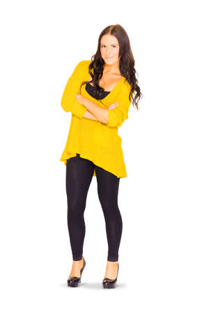 brunette woman: Studio Full Body Portrait Of A Confident Smiling Brunette Woman With Arms Folded Wearing Yellow Casual Kitted Jumper Isolated On White Background