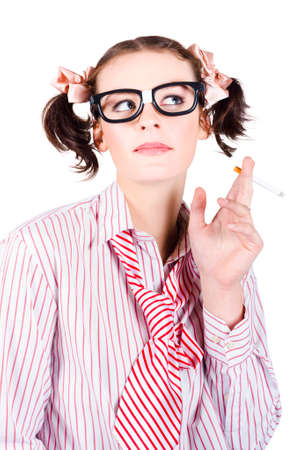 black girl smoking: Young nerdy girl with her hair in bunches smoking a cigarette