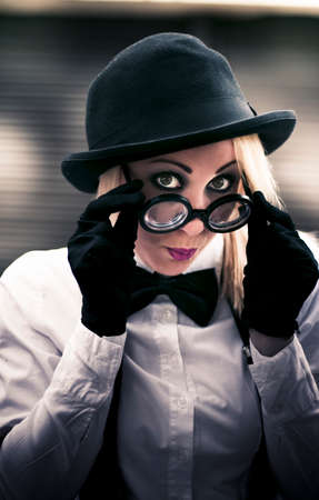 covert: Undercover Secret Agent Look Over Her Glasses With A Sexy Stare During An Clandestine Covert Operation Of Espionage