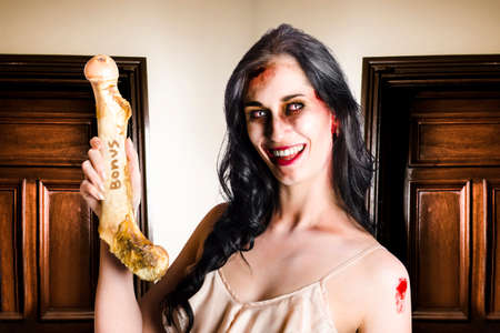 ghoulish: Grateful dead business executive holding a rotting bone when getting a premium cut in commissions in the form of a bonus