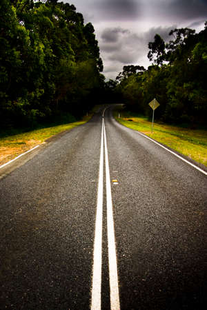 mid distance: Travel And Transport Image Of A Empty Straight Stretch Of Vacant Road Also Known As A Highway Freeway Motorway Roadway And Autobahn