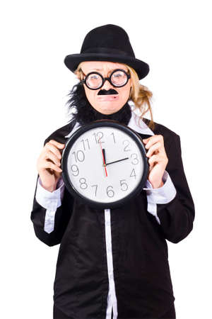 rimmed: Woman in disguise wearing bowler hat, false beard and mustache  with wide rimmed glasses holding large clock at ten past twelve Stock Photo