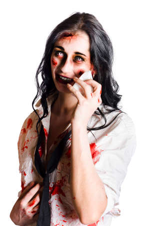 bedraggled: Young distressed zombie businesswoman with visible wounds and staring eyes  wiping her face with a cloth isolated on white background Stock Photo