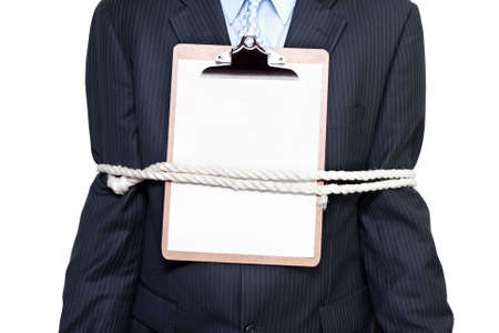 bound: Clipboard with copyspace document being worn by a male business person tied on by a sturdy rope conceptual of a signed and sealed business deal Stock Photo