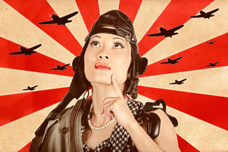freedom fighter: Retro propaganda take-off. Asian pinup freedom fighter looking up to the skies of revolution to scout the war planes of liberation