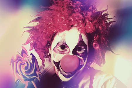 loopy: Crazy psychedelic portrait of a clown magician melting and distorting the visual cortex of reality.  Creation in act Stock Photo