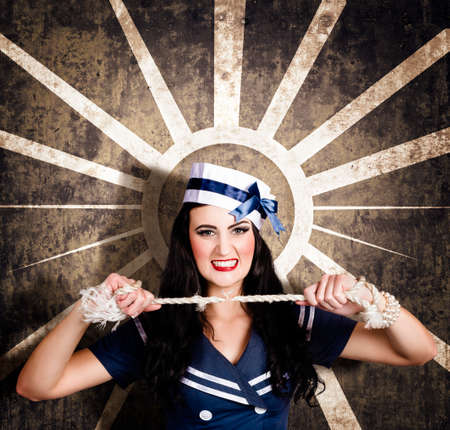 sailor girl: Sailor girl portrait. Beautiful young sexy woman breaking navy rope in retro makeup and hairstyle. Vintage design background