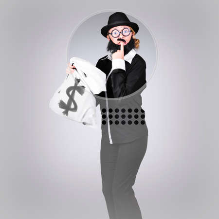 hesitant: Young business person looking hesitant while holding money at bank teller. Financial loan concept