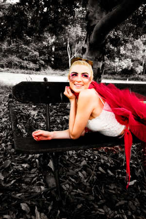 youthful: Youthful Blonde Woman In Twenties Wearing Tutu Laying With A Smile During A Outdoor Lifestyle Break