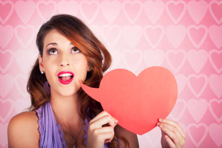 lovelorn: Romantic Woman Shouting Out Message Of Love Through Blank Heart Shaped Speech Bubble