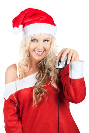 saleslady: Cute Smiling Blonde Lady Santa Claus In A Red Santa Costume Holding Up Computer Mouse In Hand Conceptual Of Online Christmas Shopping With Access To Global Stores