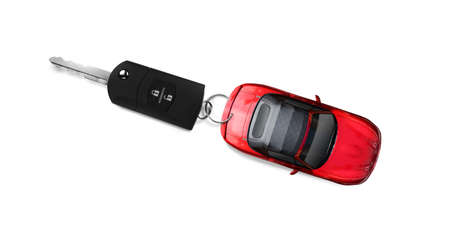 keyless: A Convertible Sports Car Towing A Might Big Car Key With Remote Keyless Entry
