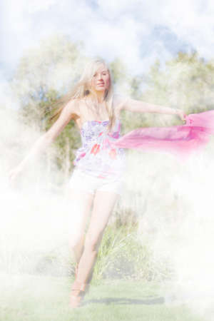 twirls: The Enchanted Forest Dancer Spins And Twirls With A Pink Shawl In A Dreamy Dance Stock Photo