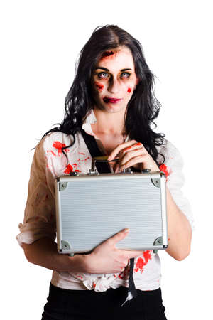 grisly: Sad Female businesswoman standing battered and bloody when being a victimised business target for workplace bullying and harassment