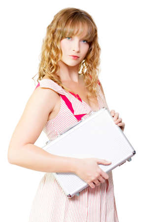 pert: Pert self-assured young blonde girl carrying a metal briefcase under her arm as she reports for her first day of work at her new job in a new work recruit concept Stock Photo
