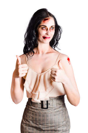 unbroken: Bruised but unbroken zombie businesswoman with thumbs up, fearless with strenth and courage concept on white background