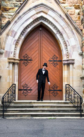 Well Dressed Man Standing At The Entrance Of A Church Door For This Is His Stairway Into Heaven Stock Photo