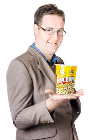 salty: Portrait Of Businessman With Popcorn Bucket Isolated On White Background