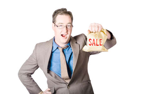 Shocked business man holding sale cash back bag when getting a markdown discount Stock Photo