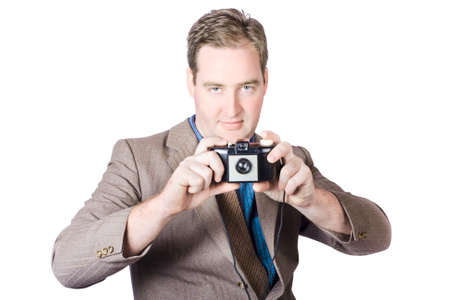 fifties: Isolated image of a man taking picture with 1950s film camera over white background. Fifties crime scene photographer