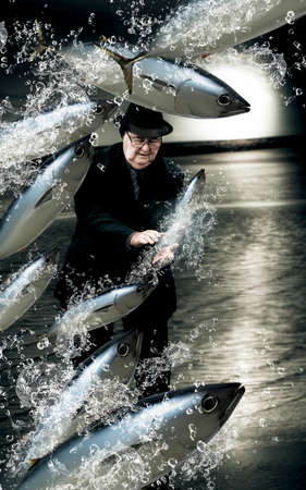 attempts: Artistic And Creative Photo Of A School Of Fish Splashing By A Senior Man Trying His Hand A Fishing For A Catch In A Plenty Of Fish In The Sea Conceptual