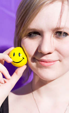 Happy Woman Holds A Smiling Ball In An Expression Of Happiness
