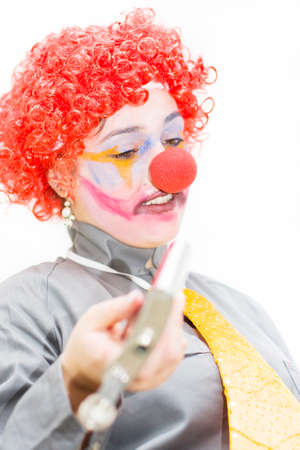 stumbling: Drunken Stumbling Clown Offering Drink From Her Alcohol Canter While Drinking During Happy Hour Stock Photo
