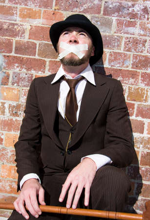 gagged: Gagged Man Is Silenced With Masking Tape Across His Mouth