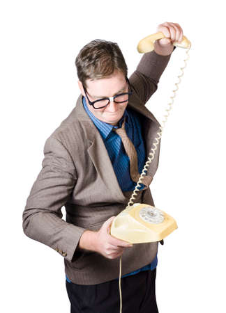 vehement: Furious business man smashing telephone after a negative conversation. Rage against the communication machine