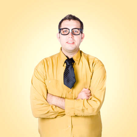 unpretentious: Friendly nerd business sales man with arms folded on yellow background. Trustworthy concept