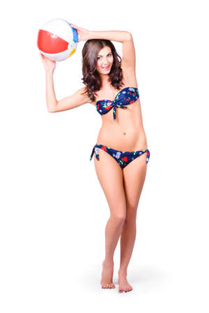 body image: Full body image of a fit and active girl in bikini playing with beach ball, isolated over white background Stock Photo