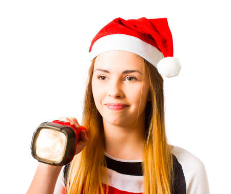 Beautiful blond christmas girl holding illuminated flashlight when on a search and find present hunt over white background