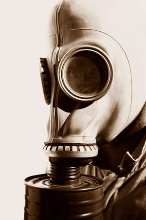 Close-up Portrait Of A Man Wearing A Historic German Gas Mask