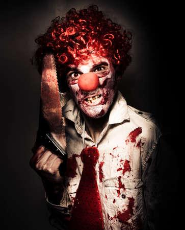 payaso: Retrato aterradora de una sierra amputaci�n enojado Carnaval payaso Tener en la oscuridad Masacre Casa