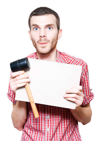 knockdown: Young Handyman Holding Card Board Sign And Mallet In A Trade Price Knockdown On White Background Stock Photo