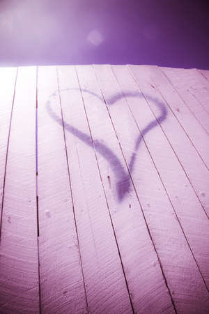 neighbour: Purple Love Heart Sign Spray Painted On A White Fence In A Neighbourhood Romance Or  Love Thy Neighbour Conceptual