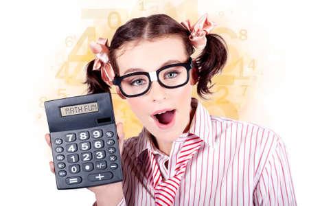 readout: Smart Female Mathematics Teacher Holding A Math Fun Calculator In A Depiction Of Educational Tutoring Stock Photo