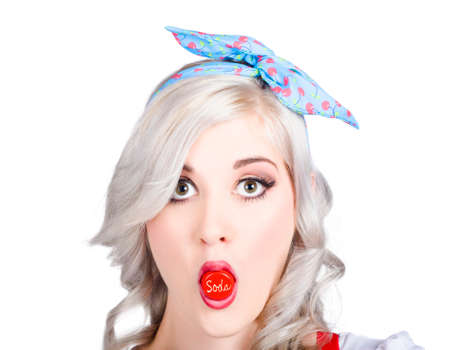 Retro girl with a soda bottle cap in the mouth with a surprised expression Stock Photo