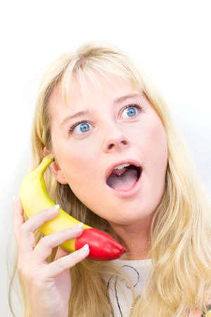 silliness: Nattering On A Banana A Female Phone Operator Shows Signs Of Being A Fruity Caller Stock Photo