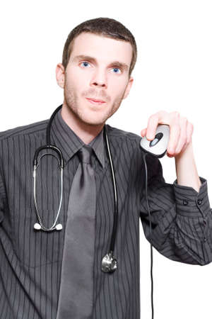 registrar: Young Male Doctor Holding Up Computer Mouse When Checking Online For Self Diagnosis Virtual Treatment Information