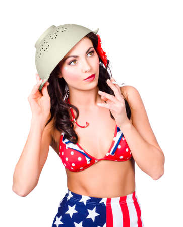 undercover: Hot American military pin-up girl wearing army green colander helmet on head while smoking rollie. Undercover special forces Stock Photo