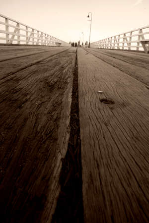 low perspective: Long Low Perspective On The Aged Wooden Planks Of Shornciffe Pier, Queensland, Australia Stock Photo